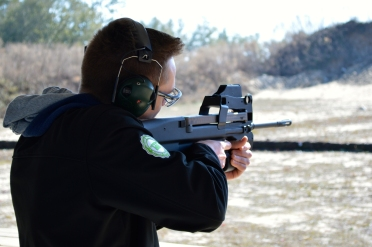 Me shooting a PS 90 on my first trip to the firing range.